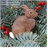Hand painted Cottontail Rabbit sitting Christmas ornament.