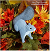 Hand painted gray squirrel autumn decoration.